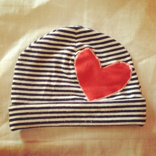 I ended up sewing another hat for my little one, this time with an appliqué heart!